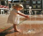 Iconic 2001 picture of girl playing with fountain water